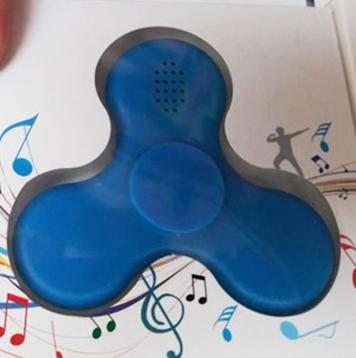 Спиннер с Bluetooth и колонками, играет музыку со смартфона